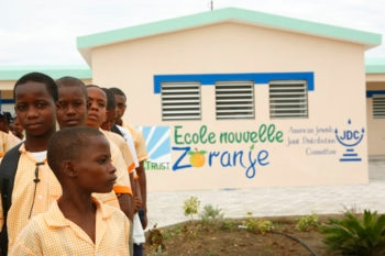 Schoolchildren from the Haitian town of Zoranje standing outside their middle school that was built by the American Jewish Joint Distribution Committee. (Courtesy American Jewish Joint Distribution Committee)