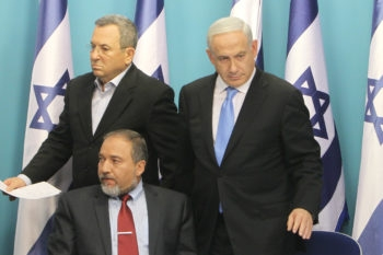 Israeli Foreign Minister Avigdor Liberman, sitting, with Defense Minister Ehud Barak, left,  and Prime Minister Benjamin Netanyahu announcing a cease-fire with Hamas at a news conference in Jerusalem, Nov. 21, 2012. (Miriam Alster/Flash90)