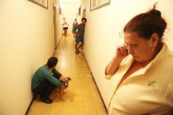 Israelis taking shelter in the stairway of their Tel Aviv apartment building as an air raid siren is heard in the area, Nov. 17, 2012.  (Yehoshua Yosef/FLASH90)