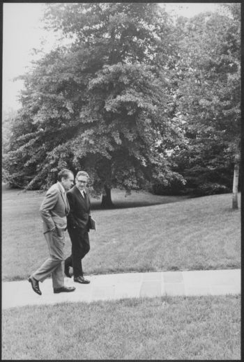 President Nixon walking with Henry Kissinger on the South Lawn of the White House, Aug. 10, 1971. (National Archives)