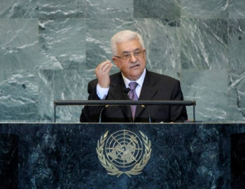 Palestinian Authority President Mahmoud Abbas, left,with U.N. chief of protocal Desmond Parker, waits to address the General Assembly after submitting a formal application for U.N. membership, Sept. 23, 2011.  (U.N./Marco Castro)