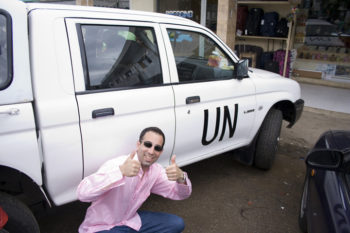 """Ami Horowitz, director of the film """"U.N. Me,"""" next to a U.N. car in Cote d'Ivoire. (Frank Publicity)"""