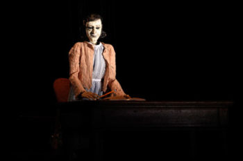 "Anne Frank is portrayed as a marionette, remembered for what she represents rather than who she really was, in the new play ""Compulsion.""  (Joan Marcus)"