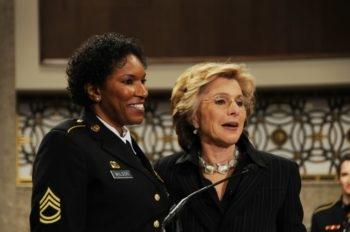 Sen. Barbara Boxer of California, right, shown presenting a Senate resolution to Sgt. Juanita Wilson, is seen as being in a close battle to maintain her seat. (Creative Commons/ The U.S. Army)