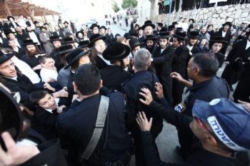 Haredi Orthodox men clash with police in the Israeli city of Beit Shemesh, Dec. 26, 2011.  (Kobi Gideon / Flash90)