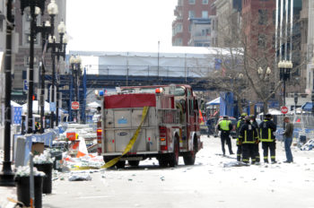 Firefighters taking over the scene of the bombing near the Boston Marathon finish line, April 15, 2013.  (Darren McCollester/Getty)