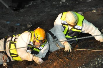 ZAKA volunteers rappelling down the hillside to find victims' remains from Carmel Forest blaze, Dec. 4, 2010.   (ZAKA)