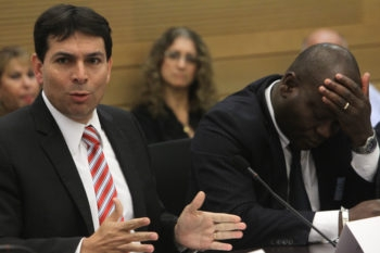 Deputy Knesset Speaker Danny Danon, left, at a Knesset hearing on the issue of African migrants in Israel, sits beside the consul general of the Ivory Coast, June 12, 2012. Danon, who advocates immediate expulsion, chairs a group called Deportation Now. (Miriam Alster/FLASH90)