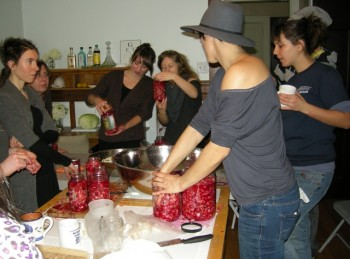 Blair Nosan, foreground right, founder of Suddenly Sauer and chair of Isaac Agree Downtown Synagogue's Education and Social Action Committee, teaches a sauerkraut workshop at Detroit's recently opened Moishe House, Nov. 20, 2011. (Dan Klein)