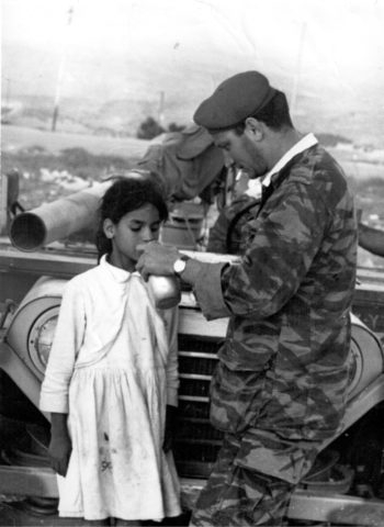 Shortly before Sgt. Eliezer Sheffer's military truck reached Basima Shafiq's home in Jerusalem in June 1967, the girl took another drink of water.  (Courtesy of Aharon Zukerman)