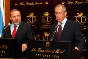 A labor dispute at Israel's Foreign Ministry nearly derailed a trip to Israel in June by Russian Foreign Minister Sergey Lavrov, seen here at a news conference with Israeli counterpart Avigdor Leiberman, when nobody came to pick Lavrov up from the airport.  (Miriam Alster / Flash90)