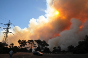 Smoke from the Carmel Forest fire rises behind the Damon prison in northern Israel, Dec. 2, 2010. (Shay Levy/Flash90)
