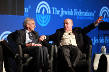 Nobel laureate Elie Wiesel, left, and Jewish Agency for Israel Chairman Natan Sharansky at the General Assembly of the Jewish Federations in North America in Baltimore discussing the Soviet Jewry movement and marking the 25th anniversary of its pinnacle event, The March on Washington, Nov. 12, 2012.   (David Karp)