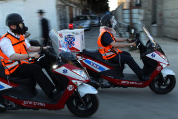 Haredi Orthodox volunteer paramedics wearing gas masks during a home-front drill in Jerusalem, June 23 2011.  (Nati Shohat/Flash90)