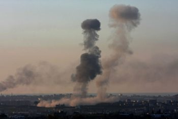 Mushroom-shaped smoke clouds rise from an explosion after an attack by the Israeli Air Force in northern Gaza on Jan. 6, 2009. (Brian Hendler)