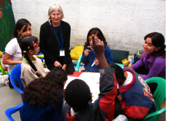 A HIAS volunteer teaching English to refugee children in Ecuador  (Steve Latimer for HIAS)