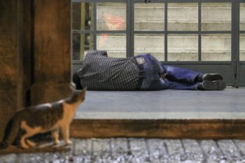A homeless man in Jerusalem taking cover in an entrance of a building to protect himself from a downpour, November 2012.  (Oren Nahshon / FLASH90)