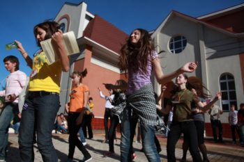 Limmud participants dance outside the synagogue in Birobidzhan on Sept. 11, 2009. (Grant Slater)