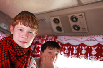 Zhenya Vladykin rides the bus to Shabbat services at the Pronkino complex on Sept. 11, 2009. (Grant Slater)