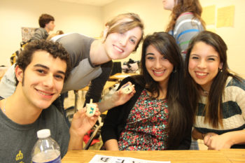 Members of the Jewish Student Union of Greater Atlanta, an organization for Jewish teens who attend public high schools, making dreidels for Chanukah.  (Courtesy National Conference of Synagogue Youth)
