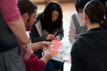 An Israeli staffer with IsraAid (on left) conducts a post-trauma recovery course with teachers in Wateri, Japan.   (Nofar Tagar for IsraAid.)