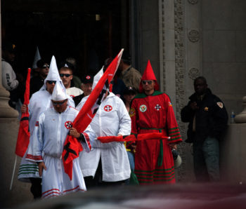 Klansmen exiting the Shelby County Courthouse in Memphis, Tenn., moments before their rally, March 30, 2013.   (Blake Billings)