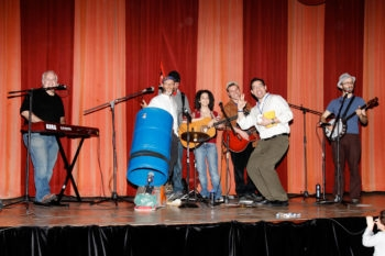 Rabbi David Ingber, right, hits the stage at the January 2010 Limmud NY with musicians, from left, Bill Jonas, Michelle Citrin and Saul Kaiserman. Partially obscured, in the black cap, is an unidentified stagehand (Limmud NY)