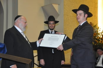 Naftoly Surovtsev, right, receiving his ordination as rabbi from Dayan Chanoch Ehrentreu at the Synagogue Community Centre in Cologne, Germany, Sept. 13, 2012. (Photo by Uri Strauss)