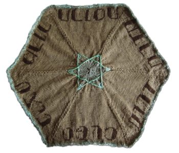 Zoe Scheffy's knitted seder plate with a Jewish star in the center. (Courtesy Diana Drew)