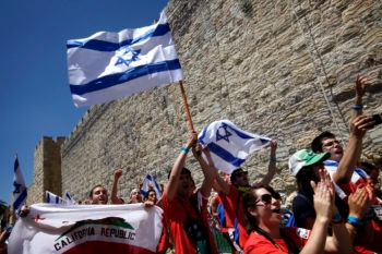 Israeli and Diaspora youths taking part in the March of the Living walk by the walls of Jerusalem's Old City on Israel's Independence Day on May 10, 2011. (Miriam Alster/FLASH90)