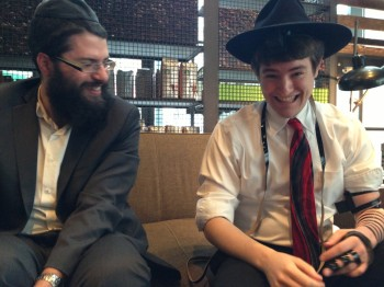 Portland Chabad Rabbi Chayim Mishulovin, left, and a recent Jewish arrival share a laugh at Starbucks.(Gil Shefler/JTA)