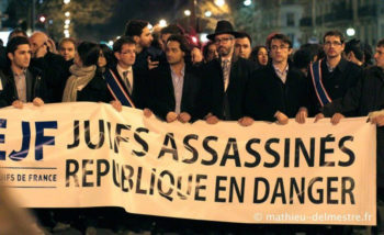 "Members of the Union of French Jewish Students demonstrating in Paris and carrying a sign that reads, ""Jews murdered, republic endangered, 2012.  (Courtesy UEJF)"