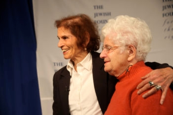 Shoshana Golan, left, a Holocaust survivor who changed her name from Rozia Beiman, reuniting in New York with Wladyslawa Dudziak, a Pole who passed her off as a family member during the Holocaust, November 2012. (Chavie Lieber)