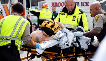 A man is loaded into an ambulance following the Boston Marathon bombings, April 15, 2013. (Jim Rogash/Getty Images)