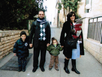 Rabbi Jonathan Sandler and his two sons, Arieh, left, and Gabriel, were killed in the shooting at the Ozar Hatorah School in Toulouse, France. The rabbi's wife is holding their daughter. (Flash90/JTA) (Flash90)
