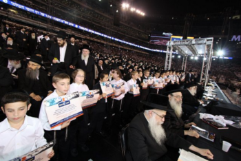 More than 90,000 people packed MetLife Stadium in New Jersey for the Siyum HaShas, celebrating the completion of the Daf Yomi page-a-day Talmud study cycle, Aug. 1, 2012. (Yisroel Golding/Siyumphotos)