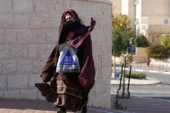 A fringe group of haredi fundamentalists in Beit Shemesh has taken to covering their faces and dressing in burka-like clothing, like the woman pictured here on Feb. 1, 2008. (Michal Fattal/Flash 90/JTA)