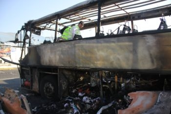 Israeli ZAKA emergency rescue team examining the remains of the bus at the scene of the terrorist attack in Burgas, Bulgaria, July 19, 2012.  (Dano Monkotovic/FLASH90)
