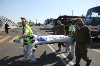 Israeli ZAKA emergency rescue team carrying a body bag with one of the victims of the terrorist attack in Burgas, Bulgaria, July 19, 2012.  (Dano Monkotovic/FLASH90)