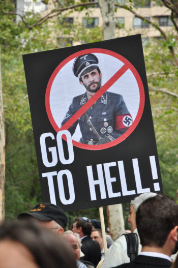 A protester at the Sept. 24, 2009 rally in New York against the Iranian regime holds up a sign portraying Iranian President Mahomoud Ahmadinejad as a Nazi. (Dave Alvarez)