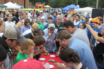 Attendees at the 23rd annual Kosher BBQ Contest and Festival in Memphis, Tenn., participate in a pickle-eating contest. (Stuart Lazarov)
