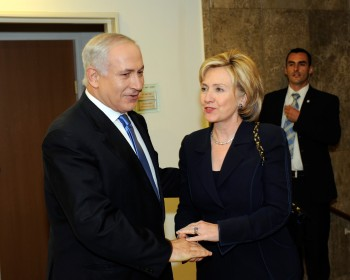U.S. Secretary of State Hillary Rodham Clinton, shown meeting with Israeli Prime Minister Benjamin Netanyahu in Jerusalem in October 2009, says the Obama administration wants to pressure the Iranian government without contributing to the suffering of ordinary Iranians. (State Department photo by Matty Stern U.S. Embassy Tel Aviv)
