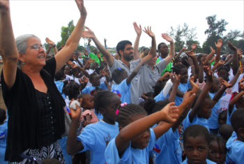 Israeli-born Sharona Nathan Elsaieh, one of the few Jews living in Haiti, celebrates with children during the inauguration of a school built by Israeli volunteers on the edge of a refugee camp in earthquake-ravaged Port-au-Prince, March 2010. (Larry Luxner)
