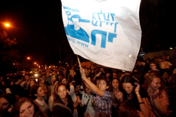 Israelis in Jerusalem celebrate the news that an agreement was reached between Israel and Hamas for the release of captive Israeli soldier Gilad Shalit, Oct. 11, 2011. (Miriam Alster / Flash90)