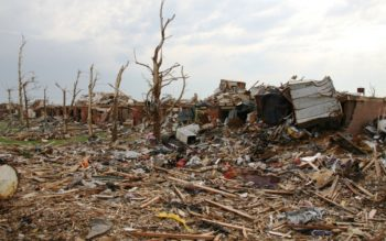 Strewn debris from the tornado that struck the Joplin, Mo., area, on May 22, 2011, shown June 14, 2011.  (John Daves/U.S. Army via Creative Commons)