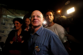 Noam Shalit, the father of captive Israeli soldier Gilad Shalit, reacts at the protest encampment opposite the prime minister's residence in Jerusalem that a deal has been reached for the release of his son, Oct. 11, 2011. (Miriam Alster / Flash90)