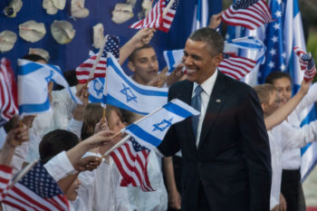 President Obama greeted by children waving Israeli and American flags at a welcoming ceremony at Shimon Peres residence in Jerusalem, March 20, 2013.  (Uri Lenz/FLASH90)