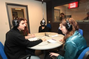 Students at ORT's Belgrano campus in Buenos Aires interview a visiting journalist at the school's radio studio. (ORT)
