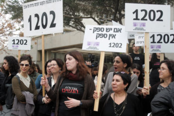 Women demonstrating outside the Tel Aviv courtroom where former Israeli President Moshe Katsav was convicted of rape and other sex crimes, Dec. 30, 2010. (Roni Schutzer/Flash90)