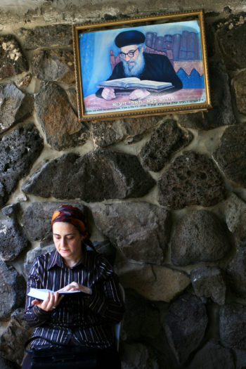 A Jewish woman reading and praying at the burial place of the Rambam in Tiberias.  (Chen Leopold/Flash 90)